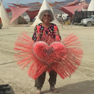 Zip and her heart sculpture that was displayed at the top of the (Inner) Freak Show Booth at Burning Man 2015
