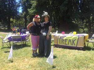 Anjanette and Julia in the park at Figment Oakland, waiting for freaks to come make flags.