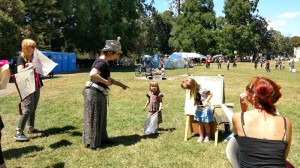Julia explaining the FYFFH project to people in the park at Figment Oakland, June 2017.